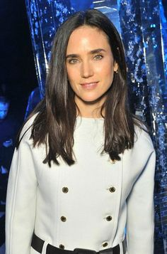 Jennifer Connelly looked stylish and sensational in a futuristic ensemble comprising of double breasted white jacket and monochrome jodhpurs with black stripes as she posed for the photographs backstage at the Louis Vuitton Fashion Show on March 9, 2016 in Paris, France. At the event, she was joined by other leading ladies of Hollywood including Alicia Vikander and Lea Seydoux.