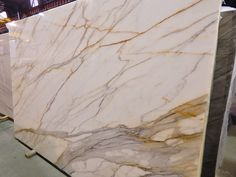 "This exotic piece is called the ""Calacatta Borghini"" (Marble) Italy is the origin of this natural stone slab. The finish of this stone is polished for shine. Very popular due to its unique look colors consist of dreamy white and slight movement of gold to"