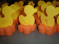 """This is a """"Duck Pond"""" carnival game made for about  three dollars. Foam cut with die cutter and swim noodle cut into slices. Cut slits in the noodle to hold the cutout of the duck upright."""