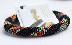 * Easy to wear, roll on bracelets. * Colourful Beads make up a stunning band of colour with a black contrast.  * Made to fit - Measure the