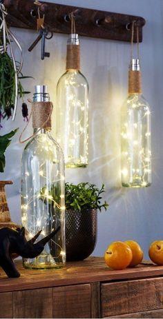 Creative Farmhouse: Wine Bottle DIY Rustic Lanterns for your home or patio decoratind. Country Home Decor Ideas Maison - Décoration à LED Bouteille de vin #farmhousedecor #countryhomedecorideas #DIYHomeDecorWineBottles #homedecordiyideas