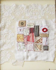 Small art quilt on antique cloth, Textile Tokens.