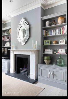 Shelves and cupboard in alcove, simple but traditional fire grate and mantel