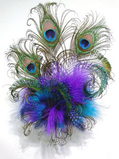 Feather Cake Topper with Peacock or your choice of feathers and colors for your Wedding, Birthday, Shower or any Special occasion cake. $41.00, via Etsy.