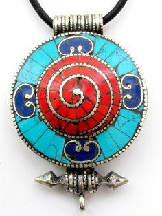 How beautiful is this Spiral Wheel Tibetan mandala box ghau pendant by Nepalbeadshop? #Tibet in #India: http://www.georama.com/blog/tibet-in-india/