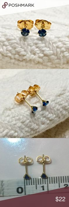 Solid 10k yellow gold blue CZ stud earrings Very pretty round cut blue cubic zirconia earrings.  The color is similar to sapphire, September birthstone.  The cz's are 3mm across.  The earrings are solid yellow gold 10k, stamped.  The backs are gold toned. New without tags. Jewelry Earrings