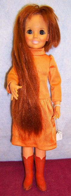 I had a Crissy doll, too - she had a knob on her back that you twisted to make her hair longer or shorter.