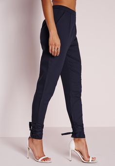 This is the tailored pant with a twist. Simple but effective, these lust worthy pants are on everyone's wishlist here at Missguided. Featuring side zip fastening, front pockets and tie detail on the ankles, pair with a black bodysuit and ba...