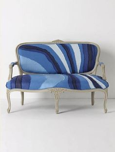 We like the idea of choosing a modern interpretation of striped upholstery for a traditional frame, like this Louisa Settee ($2,498).