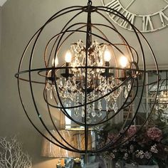 A stunning large round metal double orb chandelier with metal detail and crystal droplets. Striking statement round metal double orb chandelier with crystal droplets. *Some assembly required * SPECIAL ORDER  metal and glass crystals Entryway Chandelier, Chandelier Makeover, Industrial Chandelier, Round Chandelier, Chandelier In Living Room, Large Chandeliers, Chandelier Lighting, Wheel Chandelier, Restaurants