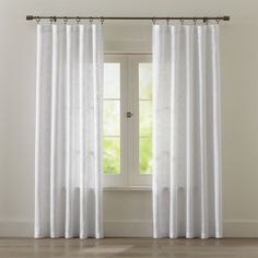 Shop Lindstrom White Cotton Curtains. Woven in a slightly open weave full of thick and thin slubs, these pure cotton panels add sheer texture along with a whisper of white. also available.