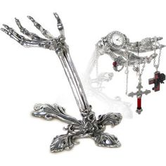 "Litternere Jewelry Stand -  A lady's maid so devoted, she serves from beyond tbe grave! Poised to assist, this skeletal, antiqued-pewter hand displays your favorite rings, pendants, and necklaces for easy selection. Handcrafted in UK. 6 "" high."