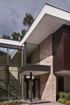 Stone and glass home in Aspen surrounded by trees