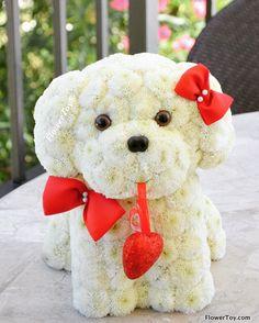 Dog made from fresh flowers.  www.flowertoy.com