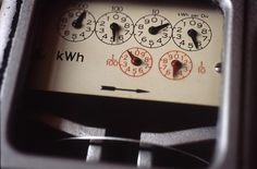 clockwork dials on an old fashioned electric meter - free stock photo from www.freeimages.co.uk