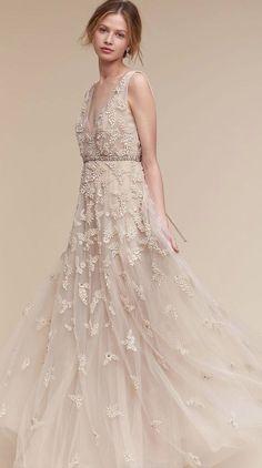 Featured Dress: BHLDN; Champagne A-line wedding dress idea.