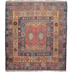 Africa | Moroccan carpet featuring Turkish and Persian tribal motifs in an original composition.  ca. 1900 | Wool pile on wool foundation