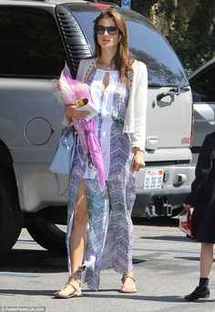 Alessandra Ambrosio shows figure in colorful dress at graduation #dailymail