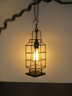 Urban Rustic repurposed vintage lantern. Espresso brown powder-coated welded cage highlights a Tesla-style, hand-wound filament bulb.