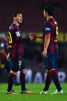 Lionel Messi of FC Barcelona shakes hands with his teammate Luis Suarez of FC Barcelona at the end of the Copa del Rey Round of 16 First Leg match between FC Barcelona and Elche CF at Camp Nou on January 8, 2015 in Barcelona, Catalonia.