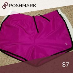 Danskin Now Shorts Elastic waist with drawstring.  Minimal wear.  Color purple,  white, black.  Too short for me.  Just like new. Danskin Shorts
