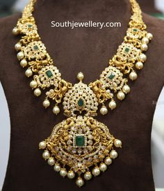 22 carat gold antique peacock pacchi haram adorned with cz stones, emeralds and south sea pearls. Jewelry Design Earrings, Gold Earrings Designs, Necklace Designs, Jewelry Necklaces, Gold Temple Jewellery, Gold Jewelry, Bridal Jewellery, Diamond Jewelry, Gold Mangalsutra Designs