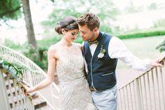 Romantic bride and groom on the stairs at a historic mansion. Sparkly wedding dress by Sue Wong, groom's attire from Revolve in Charlotte, NC. Florals by Lily Bee's, styling by Julian Michael Clark, image by Taken by Sarah Photography at the Mosteller Mansion in Hickory, NC.