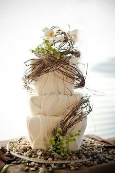 Whimsical and rustic come to mind when viewing this beautiful and artistic cake design! #rusticweddings #weddingcakes