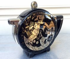 Mickey Mouse STEPPIN OUT' Teapot & Lid, black and silver ceramic. 1930's #follies dance theme, Mickey is in a top hat & tails. Made by Enesco for Disney. #MickeyMouse #Disney #Enesco #teapot