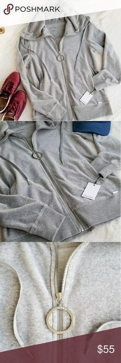 NWT Calvin Klein Sweat Jacket, Size S Calvin Klein Velour Sweat Jacket, Zip Up with two front pockets.  %80 Cotton , %20 Polyester. Heather Grey Color. Size S. NWT Excellent Condition. Calvin Klein Tops Sweatshirts & Hoodies