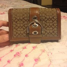 Authentic Coach wallet Cute little wallet with plenty of pockets! Used maybe for a month. In excellent condition. Small pen mark shown in picture, but not bad looking. Thanks for looking!  Coach Bags Wallets
