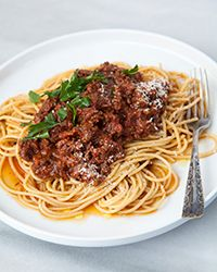 Ground beef and sausage make for a delicious slow cooker Bolognese sauce.