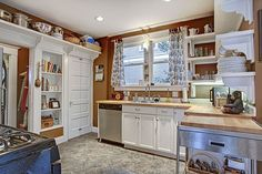 Cottage Kitchen with Flat panel cabinets, slate tile floors, Wall sconce, Flush, Limestone, European Cabinets, Wood counters