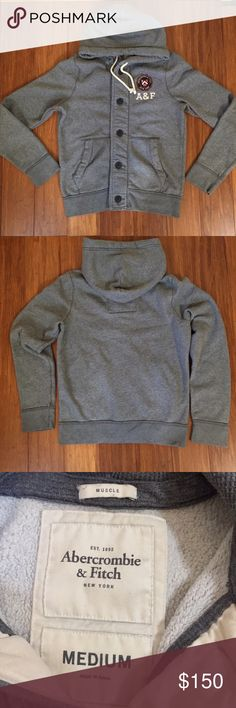 """Abercrombie and Fitch Muscle Button Up Hoodie Description: Button front, fleece lined body. 2 front pockets. Length: 27"""" shoulder to hem Chest: 44""""  Sleeve: 27"""" shoulder to wrist Waist: 18"""" flat across Defects: None Condition: Excellent 🎁Custom bundles for a special price🎁 🚫smoke 🏡 with 🐈. Washed in All Free & Clear. Abercrombie & Fitch Shirts Sweatshirts & Hoodies"""