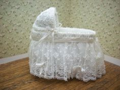 Dollhouse Bassinet 1inch white lace baby bassinet. $49.95, via Etsy.