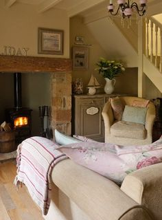Living room, Lavender Cottage. I like the idea of installing a wood burning stove in the hearth fireplace.
