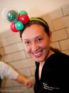 Smarty Pants also creates a wearable balloon piece, like this adorable headband, which can be customized to the party's colors (www.smartypa...