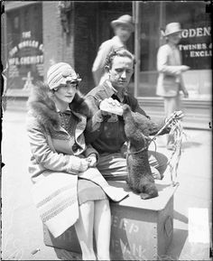 Mr. and Mrs. Charles Keohane feeding Tunney, a bear cub c. 1927. Photo from the Chicago Daily News.