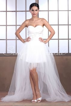 Wedding Dress by SimplyBridal. The Zoe gown boasts many fun and adorable details. Made of soft and romantic tulle for a fairytale feel, and with a flirtatious high-low hem that is youthful and ever so playful. The whole look is finished with a corset back and dazzeling beading along th. USD $399.99