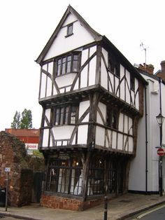 The House That Moved.   A 15th century half timber house, located in a part of Exeter's old town became a worldwide news story when it was moved, literally, to make room for a new by-pass in 1961. The house was uprooted from its foundations, encased in a wooden structure and moved 70 meters further down the road on castors to where it presently stands, no worse for the wear. Now a bridal boutique.