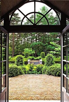 A beautiful garden view from the window.the herringbone pattern in the brick is smazing