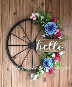 What a beautiful addition to your farmhouse decor! I started with a trendy yet classic metal wagon wheel and added lots of greenery and beautiful flowers to it. I also painted the wood sign for that special finishing touch! The sign has been sealed so its perfect for inside or