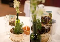 Love the living centerpieces and rustic table numbers