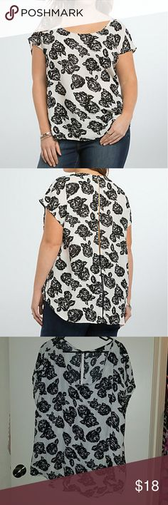TORRID Chiffon Rose Print Button Back Top This sophisticated top pairs ivory georgette with a black rose print; romantic without over doing it. Dolman sleeves make this an easy top to slip into, while the button back lets you feel the breeze. No damage. All buttons intact. Perfect for spring/summer! torrid Tops Blouses