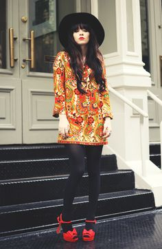 bohemian dress with black tights and red sandals