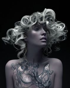 Gorgeous image by hairstylist Tony Ricci of Canada and Photographer Ara Sassoonian. Love the iridescent tattoos too! #hotonbeauty fb.com/hotbeautymagazine