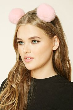 A classic headband adorned with two fuzzy pom-poms.