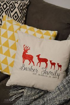 This darling pillow is a DIY project using glittered iron on vinyl. What a fun idea to make a family pillow like this! I love the deer trend.
