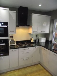 Cheap Kitchens | Discount Kitchens for Sale Online | Cheap Kitchen Cabinets Mrs Gardener - Ripon New Kitchen - Here is a beautiful high gloss cream kitchen that we supplied and fitted in Ripon, The kitchen has a lot of nice features like a single oven with the microwave directly above it in a tall tower unit, painted glass splash backs behind the cooking area of the kitchen, This