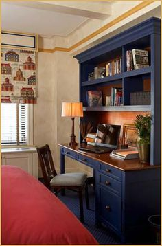 Fit for an all-American teenager, a bedroom with a patriotic palette and Colonial blue cabinetry and desk.